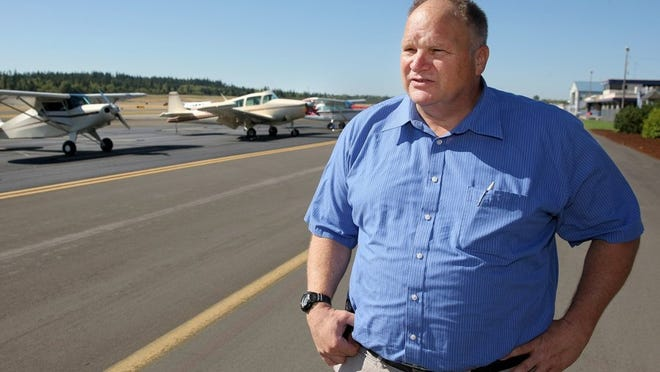 Fred Salisbury, the director of the Bremerton National Airport, was one of the central figures in bringing the Aircraft Owner and Pilots Association Fly-In to Bremerton. The Fly-In, expected to draw up to 500 airplans and thousands of people, begins Aug. 19. (LARRY STEAGALL / KITSAP SUN)