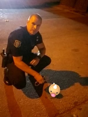 Recruit Officer Ehler poses with a Weedle he helped catch while on foot patrol in Pettigrew Heights early Tuesday morning.