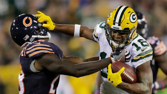 Green Bay Packers wide receiver Randall Cobb (right) stiff-arms Chicago Bears strong safety Harold Jones-Quartey during a fourth quarter reception at Lambeau Field on Oct. 20.