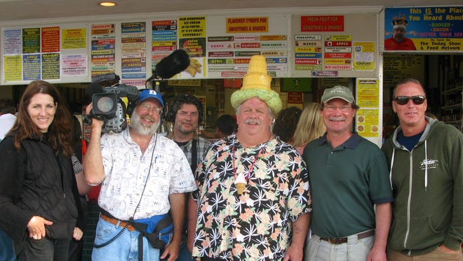 Chip Hearn, owner of The Ice Cream Store, celebrates a successful 2014 shoot with the film crew. Shown are Amy Vanneman, Bill Ward, Peter Hayes, Hearn, field producer John McCally and Thomas Healy.