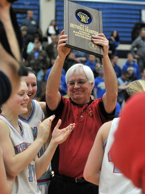 Tom Weinkauf celebrates a  WIAA Division 5 sectional title with the Newamn Catholic girls basketball team during the 2013 postseason. Weinkauf was named the Wausau West girls basketball coach Monday.