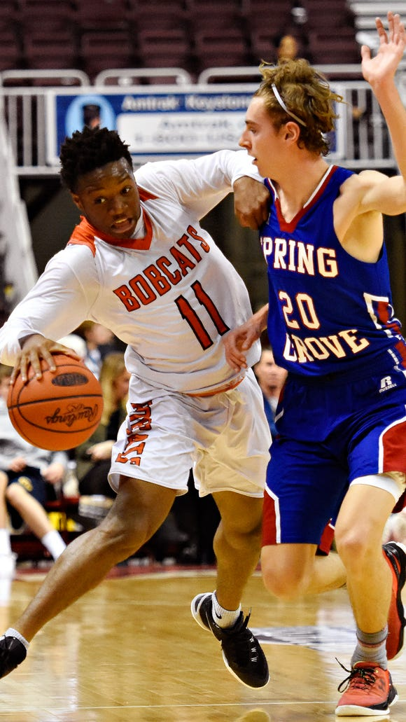 Northeastern's Fred Mulbah drives against Spring Grove's Drew Gordon during Monday's District 3 Class 5-A boys' basketball semifinal at the Giant Center in Hershey. Mulbah scored 25 points in Northeastern's 78-58 win. The Bobcats will play for the district title Friday night. Northeastern is offering a free fan bus for the game. Dawn J. Sagert photo