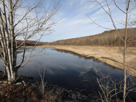 The drought has caused this land that is usually under water to become visible at this section of the Wanaque Reservoir as seen from Greewood Lake Turnpike near Sloatsburg Rd.