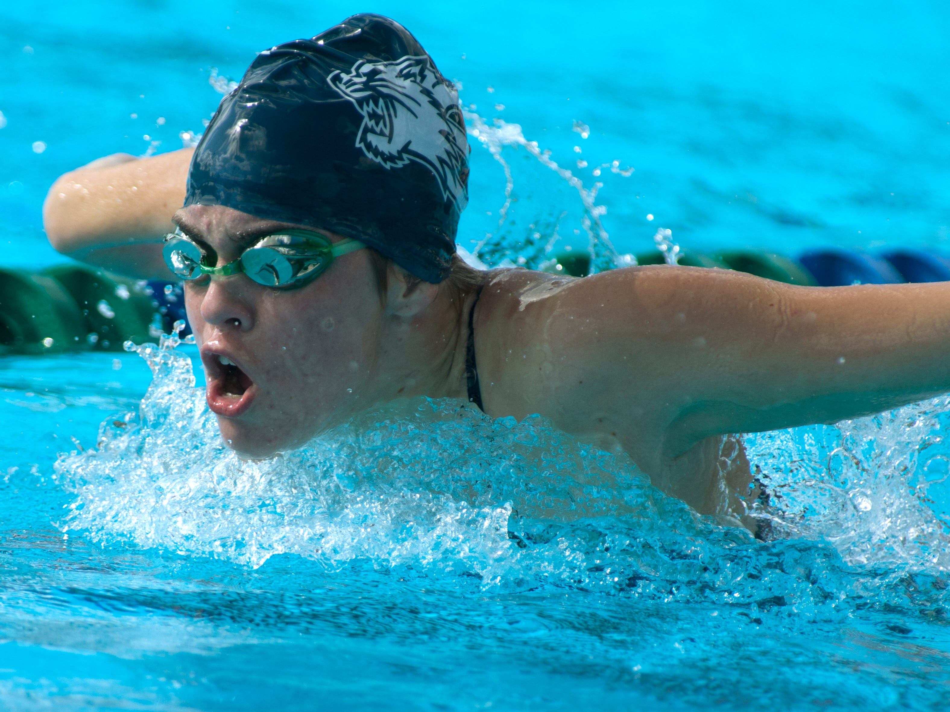 Estero High School Bean Faunce swims in the girls 100 Yard Butterfly at the FHSAA 2A Region 4 Championship, Friday (11/7/14) at The FGCU Swimming Complex.