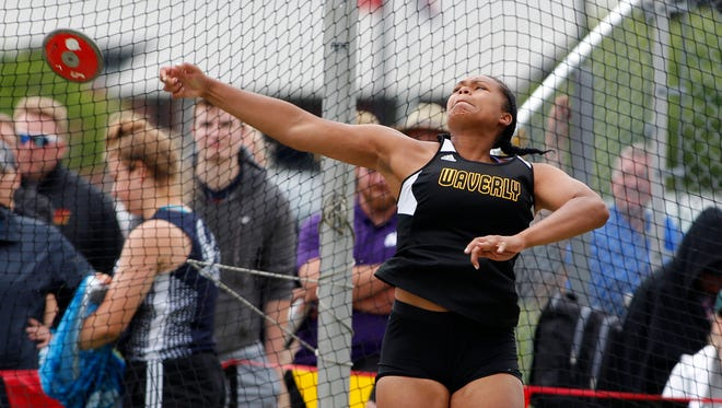 Lansing Waverly's Malin Smith throws the discus in the MHSAA Division 1 track and field finals, Saturday, June 2, 2018, at East Kentwood High School. Smith set a state record with a throw of 163 feet, nine inches.