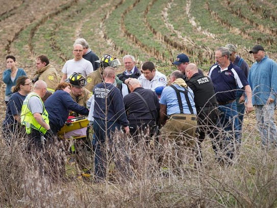 Firefighters work to rescue one of their own in West
