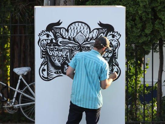 Artist W.C. Bevan live paints during the Midtown Getdown