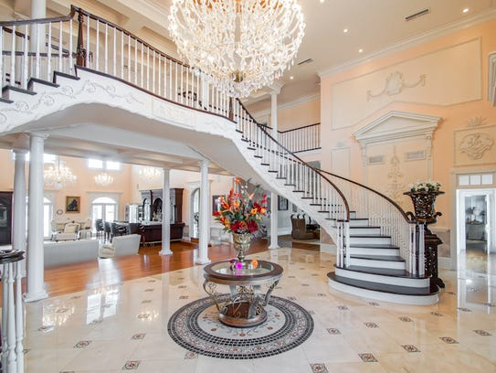 The grand entrance of this home includes a free-standing
