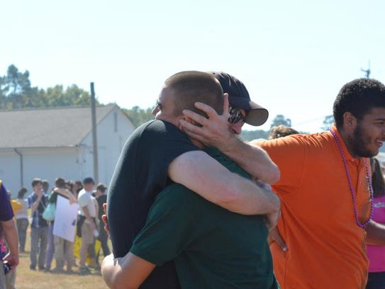 A Camp Minden Youth Challenge participant hugs a loved