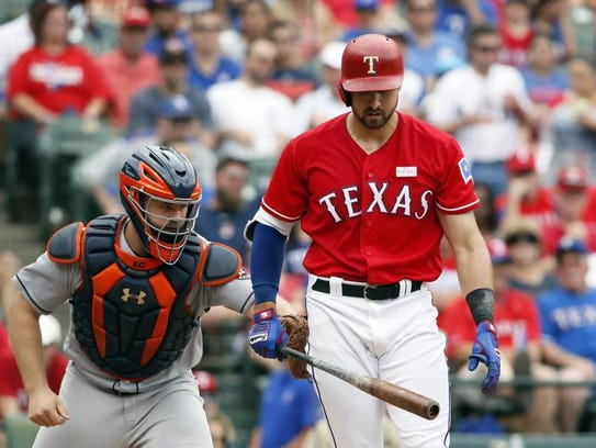 Joey Gallo (13) of the Rangers is tagged out by Houston