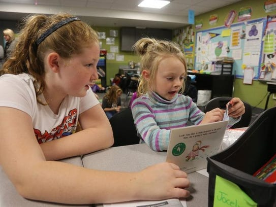 Fifth-grade student Miranda Klootwyk works with first-grader