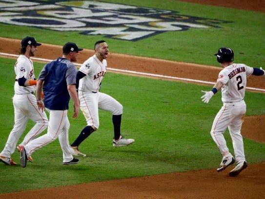 The Houston Astros celebrates after Alex Bregman's