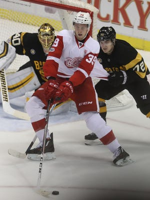 Red Wings right wing Anthony Mantha skates against Boston Bruins center Frank Vatrino during the third period Wednesday, Jan.18, 2017 at Joe Louis Arena.