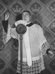 """The Rev. Charles Coughlin, known as the Radio Priest, founded the parish in 1926 and did his national radio broadcasts from National Shrine of the Little Flower's tower. The church's website says he made anti-Semitic commentaries that supported """"some policies of Adolf Hitler"""" until he was forced off the air in 1940."""