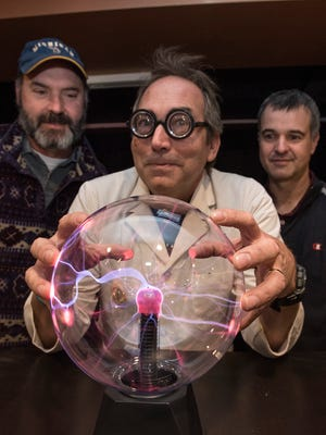 Supernatural, the name of the new brewpub and restaurant, refers to natural, fresh food and great beer, plus a little of the mysterious. Ernie Pacsai holds the plasma ball. Behind Pacsai are partners Dan Gee and Chris Hibner.