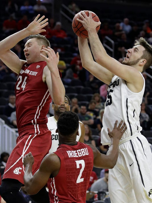 Colorado's Lucas Siewert, right, grabs a rebound over Washington State's Josh Hawkinson, left, and Ike Iroegbu during the first half of an NCAA college basketball game in the first round of the Pac-12 men's tournament, Wednesday, March 8, 2017, in Las Vegas. (AP Photo/John Locher)