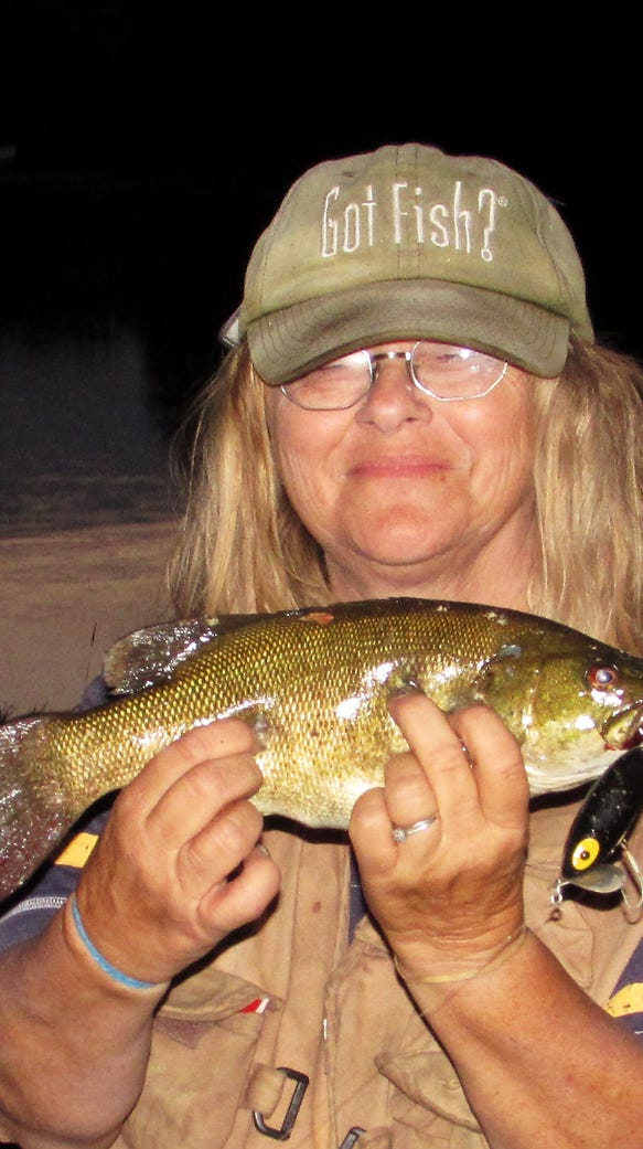 Carol hooked this smallmouth bass in the Chemung River