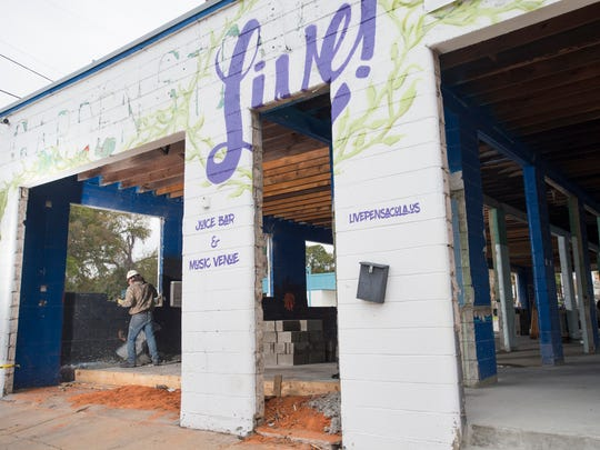 James Green, of Emerald Coast Constructors, works Wednesday, Dec. 27, 2017, to convert the old Garden Street Car Wash into the new Live! Juice Bar & Music Venue in Pensacola.