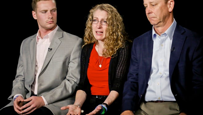 FILE - In this May 15, 2017, file photo, Evelyn Piazza, center, seated with her husband James, right, and son Michael, left, speaks during an interview in New York. The Piazza's talked about Timothy Piazza, 19, a brother, son and Penn State sophomore who died in February after he was put through a ritual at his fraternity house and forced to drink dangerous amounts of alcohol in a short amount of time.