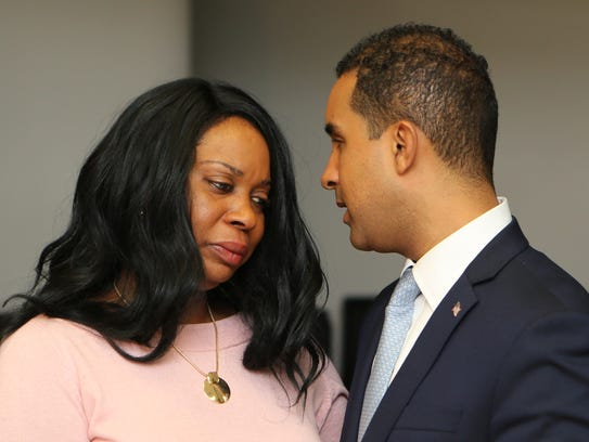 Mount Vernon Mayor Richard Thomas comforts Nadine McKenzie,