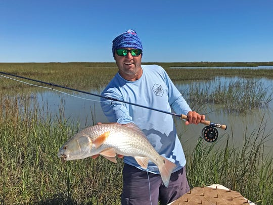 Joey Farah snagged this redfish in a shallow pool surrounded