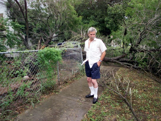 Oley Castro checks out the damage from Hurricane Bret