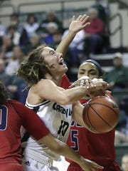Green Bay's Mehryn Kraker (10) is hacked by Illinois-Chicago's Taylor Toney (5) on Monday at the Kress Center.