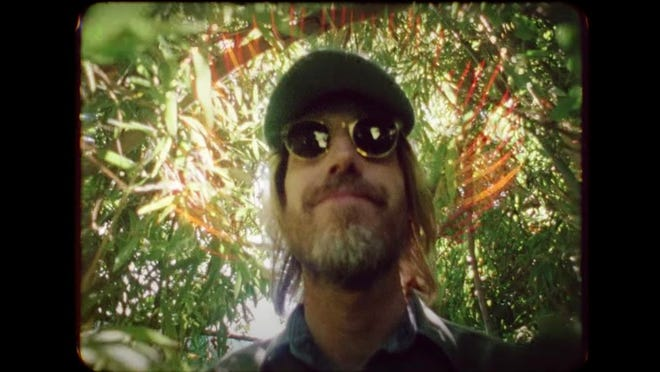 """Tom Petty, as seen in the video for the home recording of """"Wildflowers,"""" featuring previously unreleased footage of Petty at his home, shot by Martyn Atkins and directed by Alan Bibby and Jonny Kofoed."""