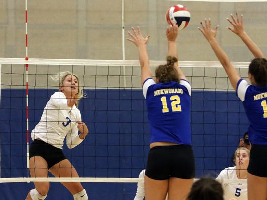 Maddy Rondeau of Catholic Memorial hits the ball over
