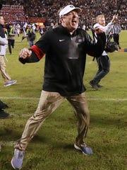 Georgia head coach Kirby Smart celebrates as time expires for a 21-14 victory over Auburn in an NCAA college football game, Saturday, Nov. 16, 2019, in Auburn, Ala. (Curtis Compton/Atlanta Journal-Constitution via AP)