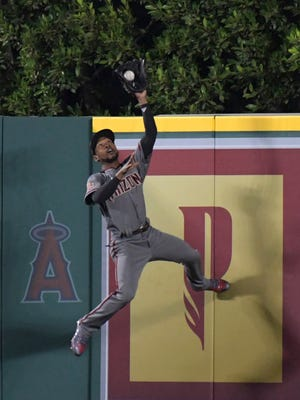 Jun 18, 2018: Arizona Diamondbacks center fielder Jarrod Dyson (1) makes a leaping catch at the outfield wall of a fly ball by Los Angeles Angels left fielder Justin Upton (not pictured) in the seventh inning at Angel Stadium of Anaheim.