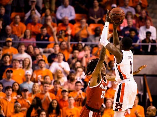 Auburn Tigers guard Jared Harper (1) shoots over Alabama