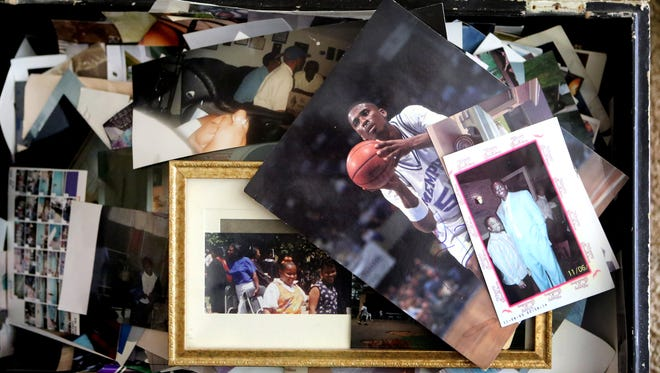 June 26, 2015 - A chest full of family photos many of Lorenzen Wright. Deborah Marion, Lorenzen's mother, spoke about her son and the events surrounding his death 5 years ago.