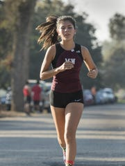 Mt. Whitney's Isabella Haberman leads the girls varsity race in the West Yosemite League cross country championship on Wednesday, November 9, 2016 in Visalia. The event included runners from El Diamante, Golden West, Hanford, Hanford West, Lemoore, Mt. Whitney and Redwood.