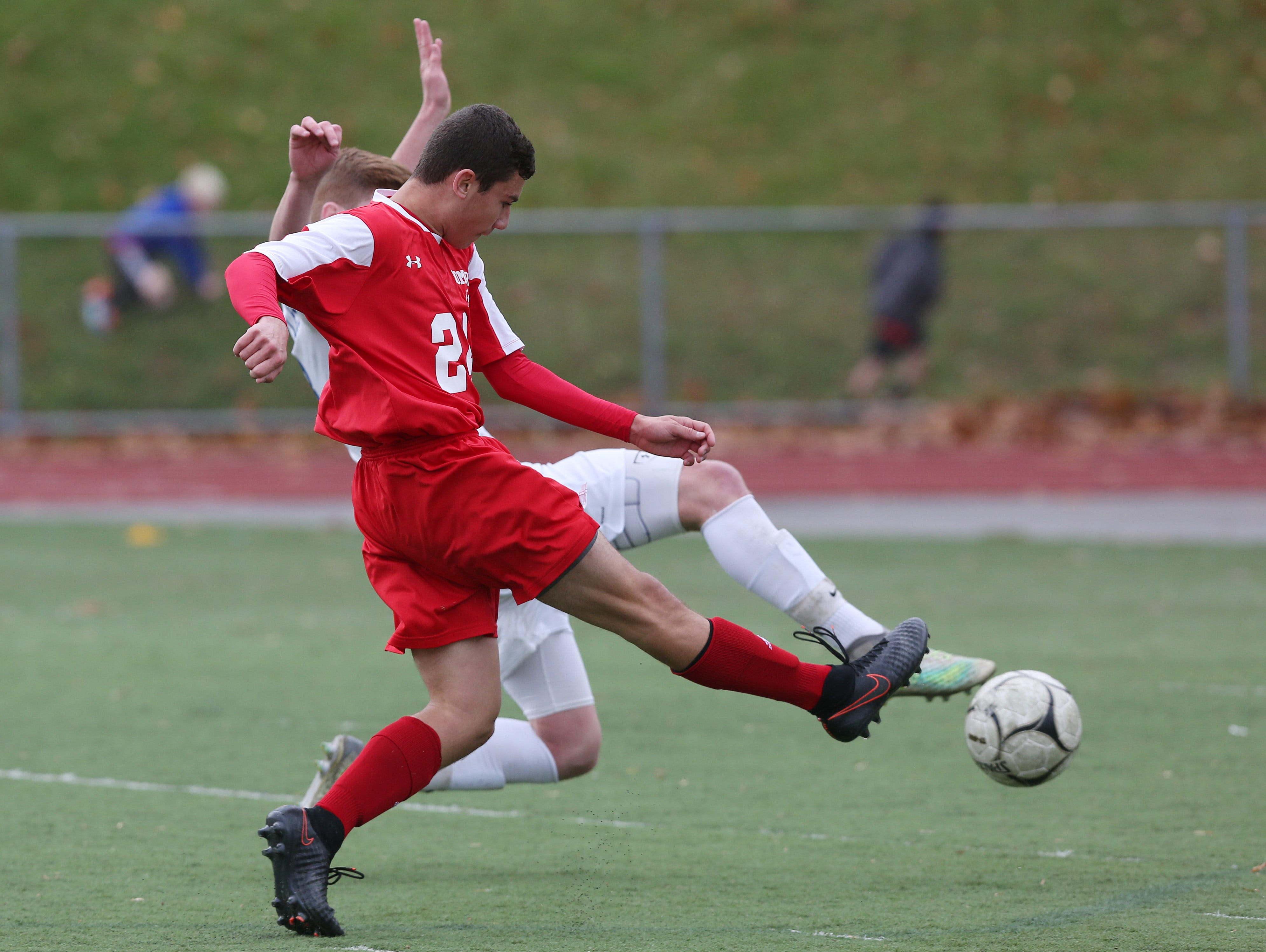 Somers' Andrew Lasher (24) gets a shot by a Pearl River defender for what would prove to be the game winning goal in the Section 1 Class A championship game at Lakeland High School in Shrub Oak High School Oct. 29, 2016. Somers won the game 1-0.
