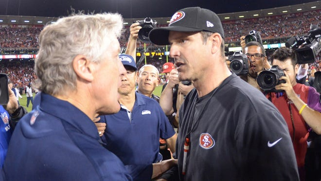 49ers coach Jim Harbaugh, right, has a 4-2 edge on Pete Carroll's Seahawks since their coaching rivalry resumed in 2011.