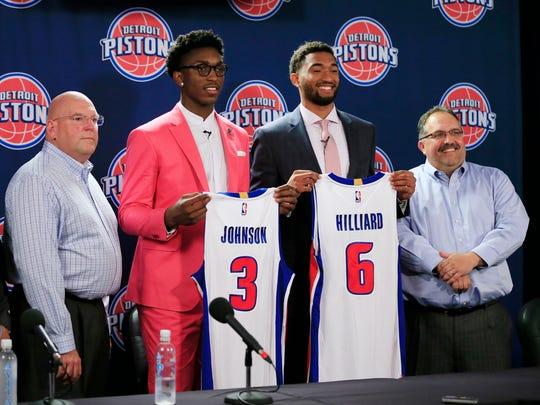 The Detroit Pistons new draft picks, Darrun Hilliard, (6) and Stanley Johnson stand with, from left, GM Jeff Bower, and Pistons head coach and president Stan Van Gundy, right, at a news conference, Saturday, June 27, 2015, in Auburn Hills.
