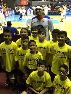2016 Tamuning Typhoons traveling team completed its Manila friendship tour games in July attending a PBA game as guests of pro player Harvey Carey with Talk-n-Text. Carey a supporter of the Typhoons took time out at half time for a pic with the team. Traveling team members kneeling are Kana Sgambelluri and Noah Cruz. Standing left to right are Aisaiah Bumagat, Jordan Madrazo, Josiah Madrazo, Yoshi Sayama and Jaden Santos. Back row Tobias Quitugua, Gio Palad, Harvey Carey and Ryu Reklai.