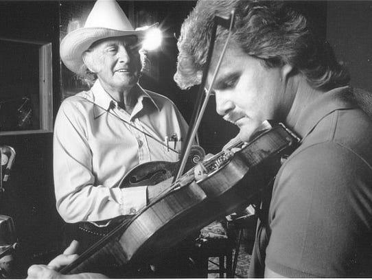 Bluegrass musicians Ricky Skaggs (right) and Bill Monroe
