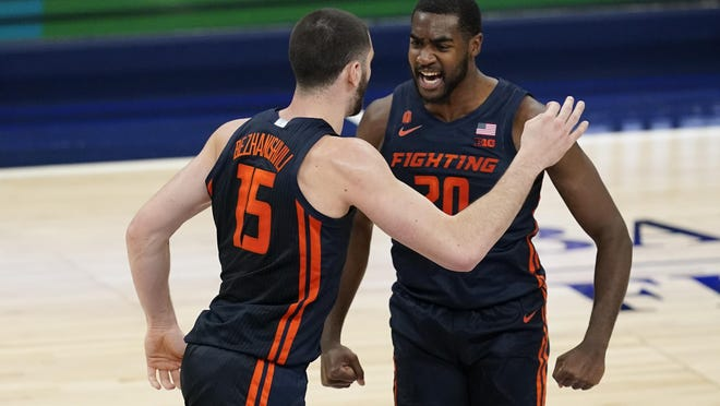 Illinois' Giorgi Bezhanishvili (15) celebrates with Da'Monte Williams (20) after Bezhanishvili hit a three-point shot during the first half of an NCAA college basketball game against Baylor, Wednesday, Dec. 2, 2020, in Indianapolis.