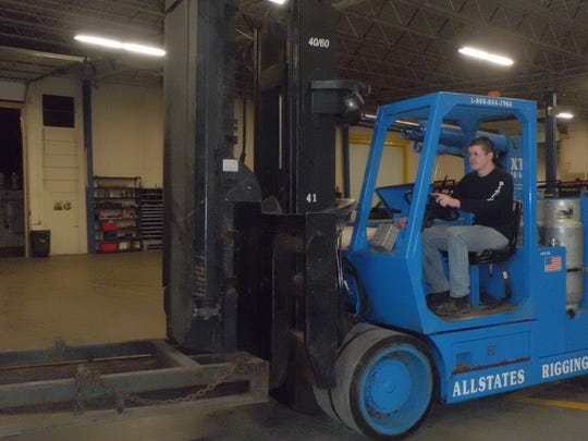 Kyle Reynolds and other crew members at Allstates Rigging operate a couple dozen forklifts including those capable of lifting about 50 tons.