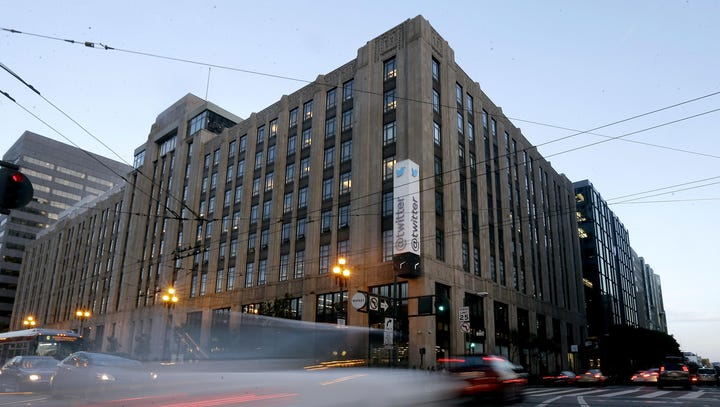 Traffic drives past Twitter headquarters in San Francisco,