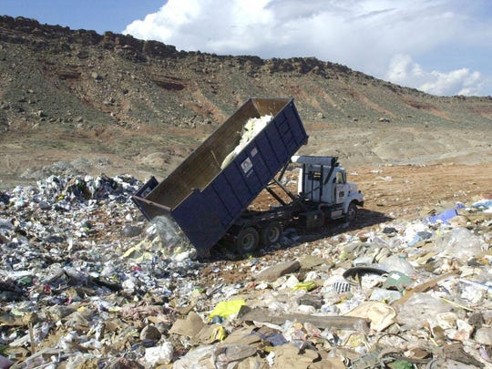 A dump truck unloads at the Washington County Landfill in this Spectrum Media file photo. Local communities are planning to implement a new curbside recycling program by early 2016.