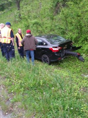 A car runs into a ditch after being rear-ended early Tuesday morning.