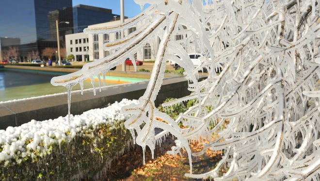 Ice from a water fountain covers a tree at Thalia Mara Hall