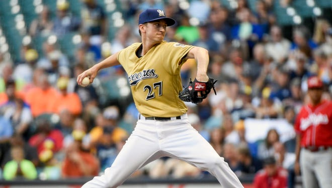 Brewers starter Zach Davies gave up five runs in five-plus innings, including four runs in the Reds' eight-run sixth.