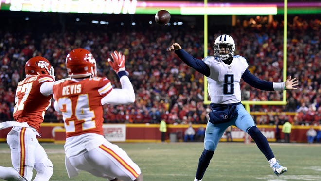 Titans quarterback Marcus Mariota (8) passes on a play that was deflected and ultimately caught by Mariota, leading to a touchdown during the second half Saturday at Arrowhead Stadium.