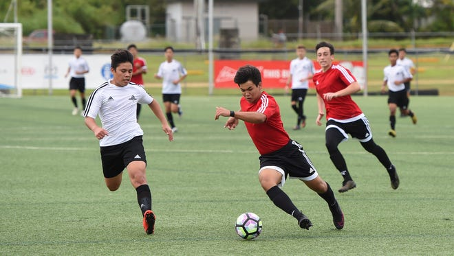 St. John's player Gavin Moore takes the ball downfield against the Father Duenas Friars during their Independent Interscholastic Athletic Association of Guam boys soccer game matchup at the Guam Football Association National Training Center in Dededo on Oct. 31. The Friars won the contest 3-0.