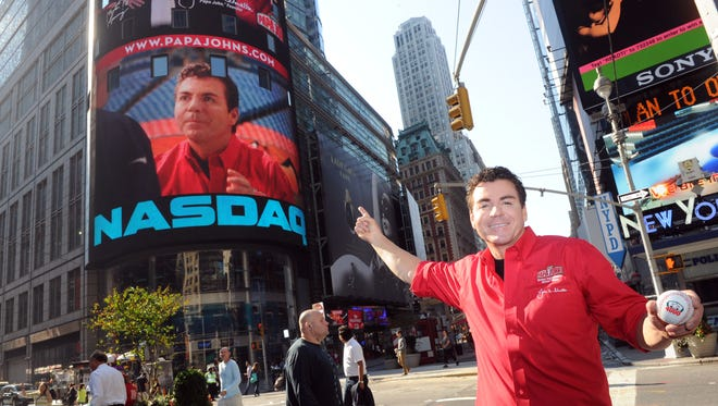 Papa John's Founder, Chairman and CEO John Schnatter gets a kick out of seeing his image on the NASDAQ tower in New York's Times Square, Friday, Sept. 14, 2012, while celebrating the opening of the brand's 4,000th global restaurant.