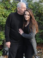 Gaetano Acerra, 58, kisses his daughter, Alexis Acerra,